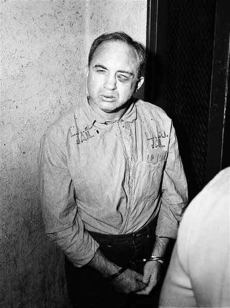 Mickey Cohen, 1930s-1960s Los Angeles gangster, looking a tad beat up.