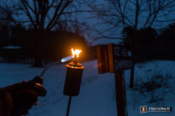 Lighting the torches - Devil's Lake State Park Candlelight Snowshoe, Feb 2017