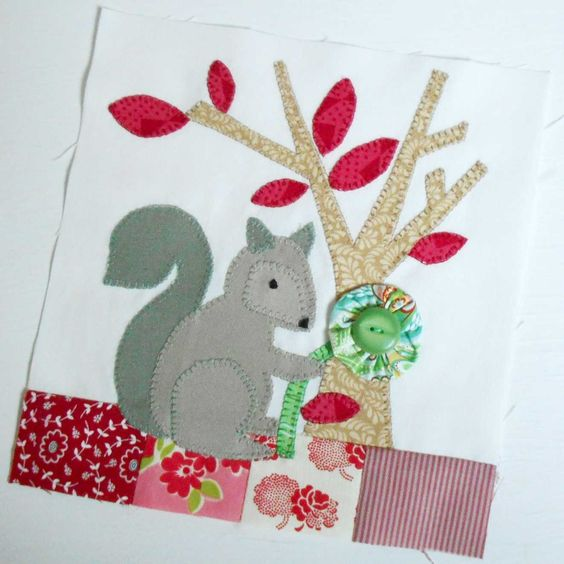 The Splendid Sampler Block 45 - Sewing Nut.  In my world squirrels collection yo-yo flowers and the forest floor is patched.