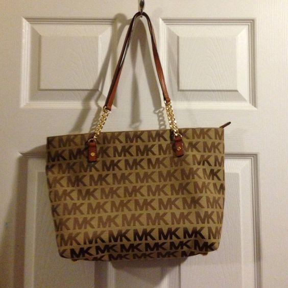 Michael Kors logo bag Used once, good as new. Michael Kors Bags