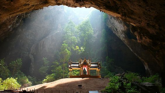 In Khao Sam Roi Yot National Park lies the Phraya Nakhon Cave, which shelters a gorgeous royal pavilion. Who wouldn't want to visit that? The cave is actually two sinkholes that collapsed, creating a sunlit cavern. Roots dangle down from above and trees grow up from the bottom. The cave was first discovered about 200 years ago by its namesake, the Thai ruler Phraya Nakhon, who was forced ashore during a storm. The pavilion is a symbol of the Prachuap Khiri Khan province, and traditionally…
