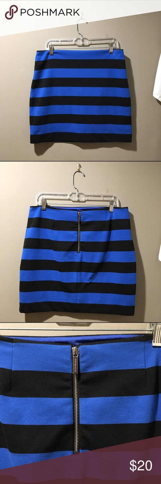 Michael Kors Striped Black and Blue Skirt This skirt is so incredibly comfortable! From the Michael by Michael Kors line, this blue and black thick striped skirt is a thicker knit that has a good amount of stretch to it and is perfect to dress up or down. Wear it casually or dress it up for the office with heels and a blazer, the options are endless. Incredibly comfortable, with an exposed back zipper and in good used condition, this is a great addition to any closet! Michael Kors Skirts…