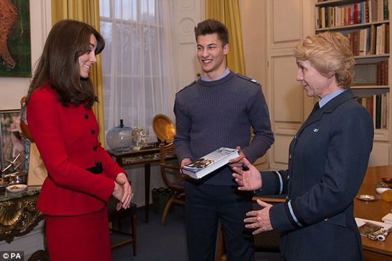 Tommy (centre) and Air Commodore Dawn McCafferty  present Kate Middleton (left) with the book Horizons, the History of the Air Cadets: