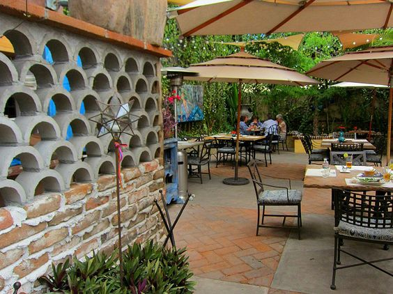 Abstract metal sculptures, dangling lanterns, and large rustic earthenware dominate the interior courtyard at Villa Valentina, a family-owned restaurant, cocktail bar, and home décor studio all rolled into one. Just as creative as the design is the menu, which features adobo-marinated gorditas de conejo, and a slow-cooked Baja lobster bisque, thickened with brandy, brown rice flour, and a hint of red pepper.