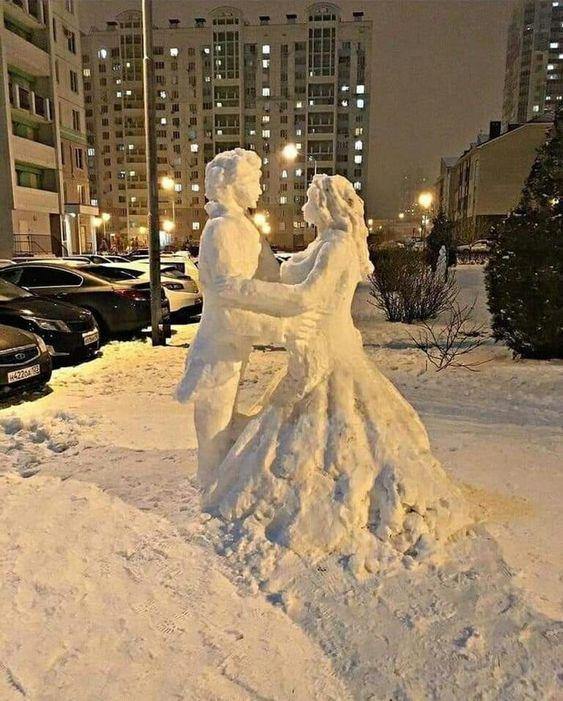 couple dansing snow sculpture #snowSculpture #snow #winter #sculpture #people