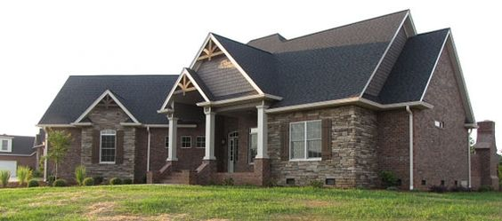 Great curb appeal with its mix of stone brick and cedar for Mixing brick and stone exterior
