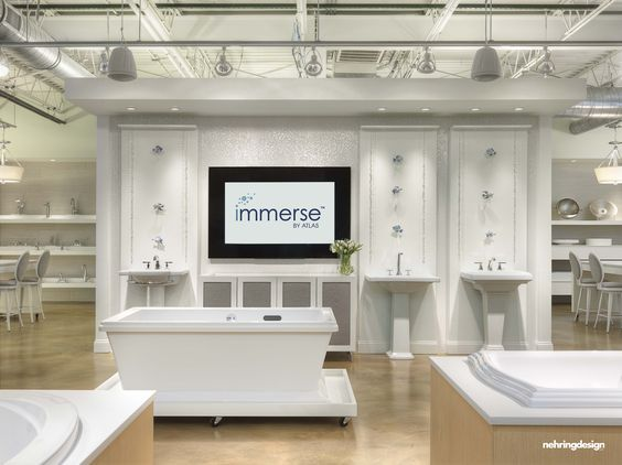Woodwork behind pedestal sinks immerse plumbing showroom - Bathroom design showroom dallas tx ...