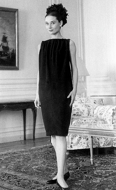 1958 Audrey Hepburn poses in a wool sack dress that is softly gathered at the boatneck and falls straight to the hem by Givenchy