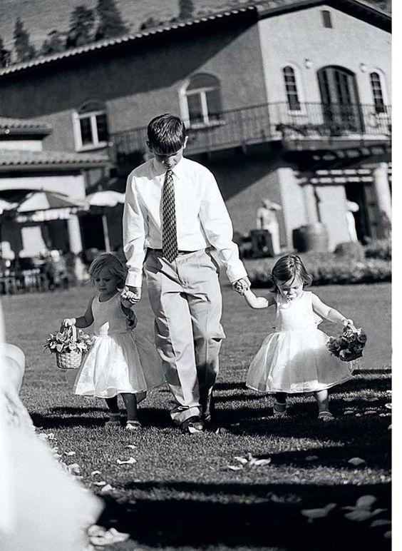 Adorable! The ring bearer escorting the flower girls