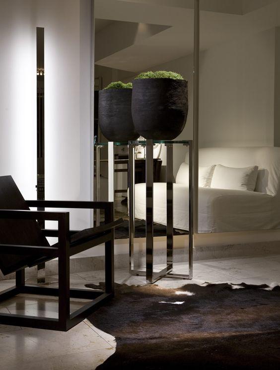 matt black antique vase with moss on contemporary sliver stand - Portfolio | Michael Dawkins Home