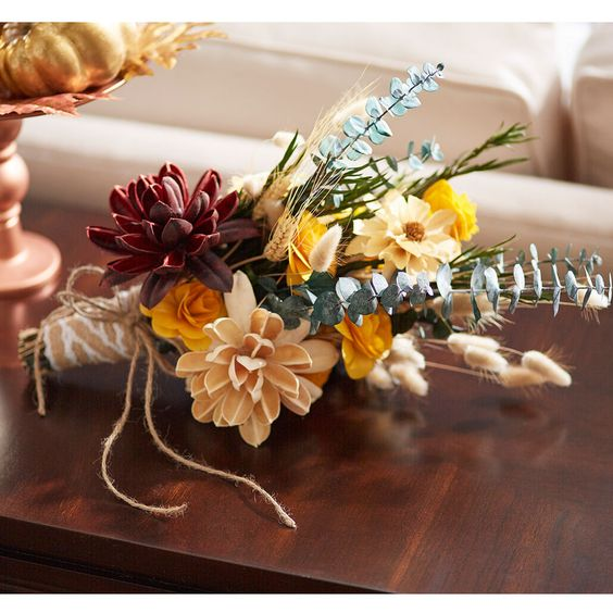 Transition from summer into fall home decor with an easy DIY dried floral bouquet.