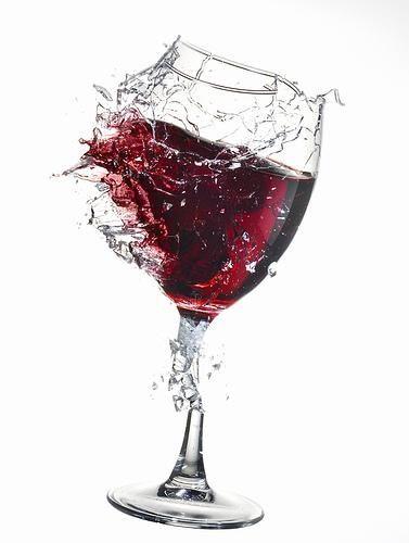 0 broken glass of red wine