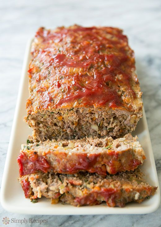 BEST meatloaf ever! Includes ground beef and Italian sausage, and a savory base of carrots, onion, and celery. Perfect comfort food. On SimplyRecipes.com