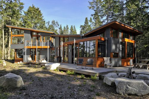 Sloped roof next to butterfly roof. Nu-Wave corrugated metal siding from AEP Span with a Zactique II finish. (House by David Vandervort Architects.) Houzz. http://www.houzz.com/discussions/73525/Does-anyone-know-manufacturer-of-this-siding---#