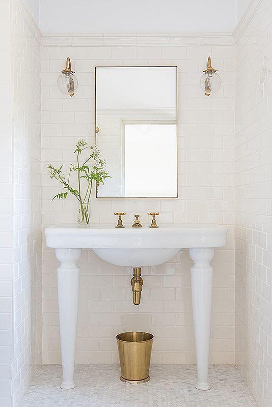 White bathroom with farmhouse style console sink, gold fixtures, and shiplap. #whitebathroom #shiplap #modernfarmhouse