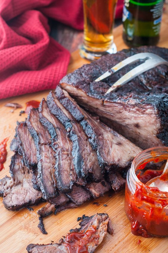 """Amazing hickory smoked beef brisket. Our motto for this smoked, tender, juicy and delicious brisket is """"Go big or go home""""! Cooked for 10 hours and smoked for 6. Smoked beef brisket heaven!. Made in our new Bradley Smoker."""