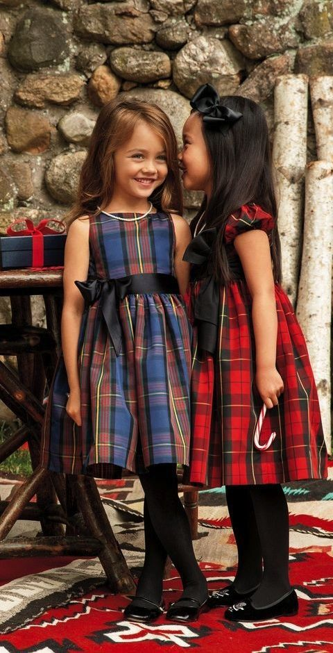 These heritage-inspired Ralph Lauren tartan party dresses have a darling fit-and-flare silhouette and a contrasting grosgrain sash.: