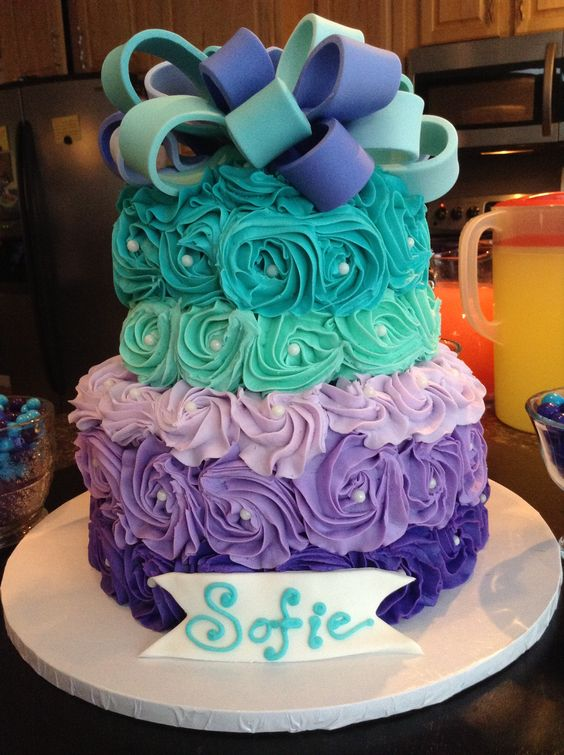 Birthday cake with roses in jewel tones and a big bow - Jewel cake decorations ...