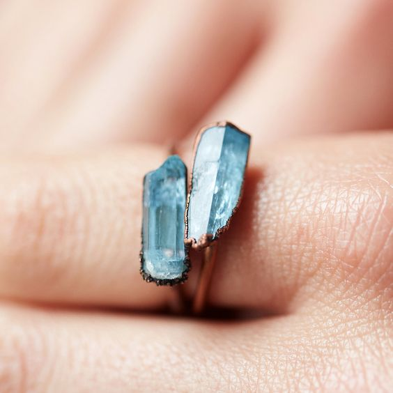 A tiny, raw aquamarine crystal centers this electroformed copper ring from Hawkhouse. Born in Lincoln, Nebraska, self-taught metal mixed metal artist Jessica Kramer of Hawkhouse has since traveled to 6 of the 7 continents gathering gems and inspiration. Today, she resides on the island of Martha's Vineyard, crafting raw mineral jewelry that is influenced by her love of science and nature.- Raw aquamarine, electroformed copper- One-of-a-kind raw stones; variation in size, shape, and color will...