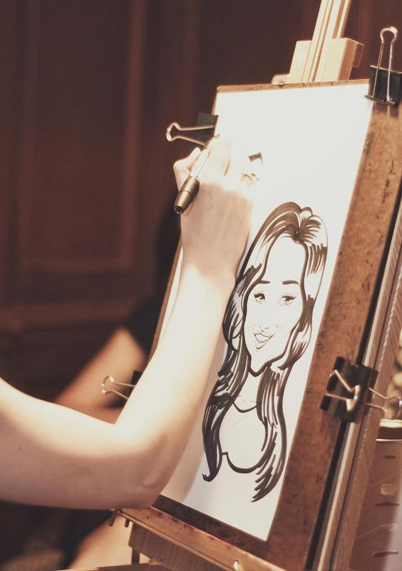 A Caricature Artist   10 Ways to Make Your Cocktail Hour More Fun   https://www.theknot.com/content/ways-to-make-your-cocktail-hour-more-fun