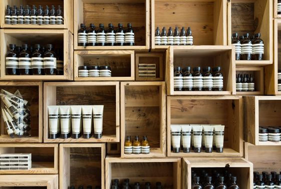 / Aesop Fillmore Street. Have wine crates set up like this behind bar, and use as wine and alcohol storage.  Mirrors set in to the back of the crates?