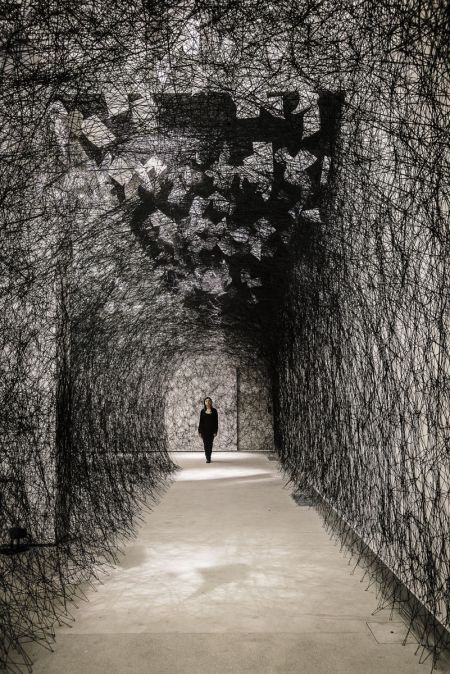 Chiharu Shiota, Japa (b.1972)_ Chiharu Shiota is known for her performative installations in which she weaves human-size webs from black thread, turning entire galleries into labyrinthine environments and often enclosing personal objects or even herself. Inspired by the installation and performance art of the 1970s, Shiota left Japan for Berlin to study under Marina Abramovic