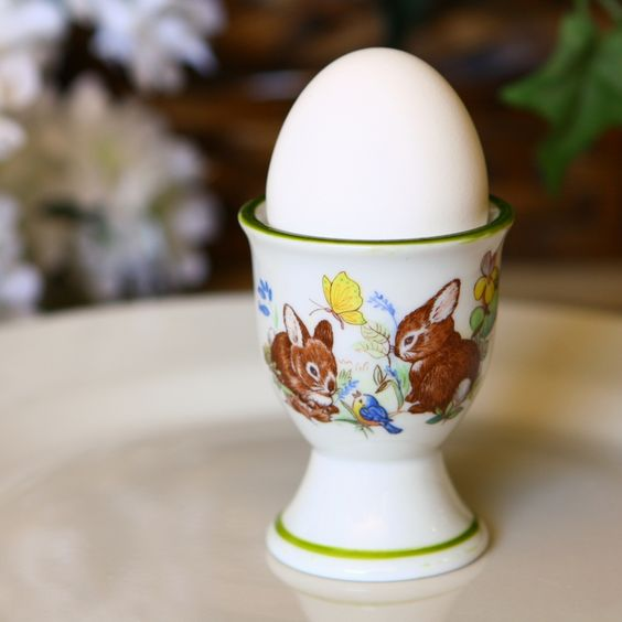 "#eggcups #Easter Adorable bunnies in a sweet forest setting adorning your morning egg cup. What could be better? The design wraps all the way around the egg cup so you can enjoy the scene from every angle. Hand-painted banding in a soothing shade of green adds the perfect finishing touch.  Made of durable porcelain, all of our egg cups are oven, dishwasher and freezer safe.  Oven, dishwasher and freezer proof Fully vitrified for heat and shock resistance Dimensions 2 x 2 3/4"" Material…"