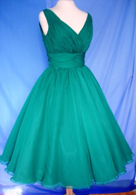 An endearing emerald green simple yet elegant 50s style cocktail ...