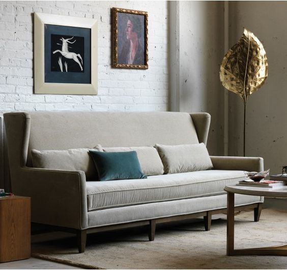 Our riff on the traditional English manor sofa plays up the high drama of a winged back and dials down the conservative tone with a streamlined silhouette, trio of lumbar dec pillows and a modern bench cushion.