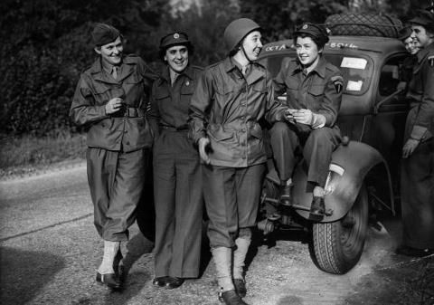 16th November 1944: Two WAACs (Women's Auxiliary Army Corps) are part of a convoy of ATS drivers going to Paris and will be among the first women to drive their own vehicles through France. Left Jean Barrett of NY State and second from left in the helmet, Corporal Jo Puo of Indiana ~