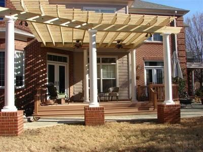 Attached pergola with round columns brick pergolas for Round porch columns