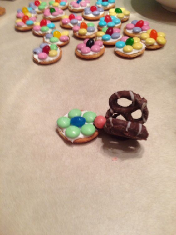 Butterflies and flowers Choc covered pretzels dips and set for wings, fruit bits for head, nilla wafer for flower base, frosting, M&M's for petals and jelly bean for center. Great way to use up easter candies for a cute preschool spring treat!