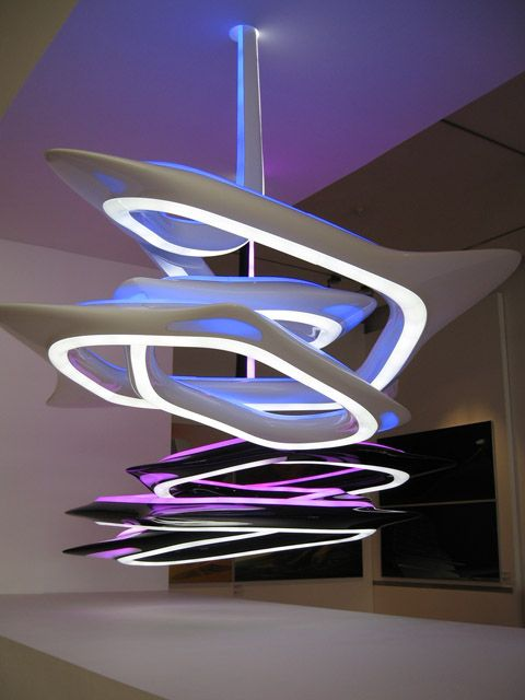 The Vortexx Chandelier by Zaha Hadid highlights the spirit of fluidity. It appears as an endless ribbon of light.