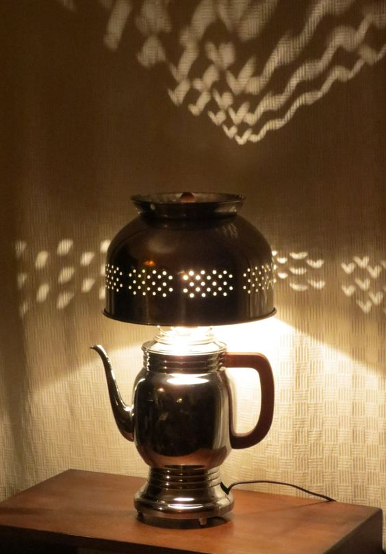 A vintage chrome percolator and stainless steel colander