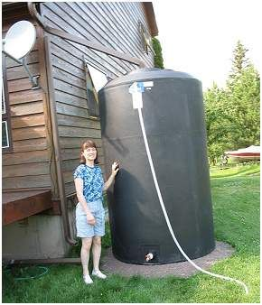 A typical house has a roof area of 1,200 square feet and four downspouts that will each drain about 300 square feet of roof. That means a rainfall of 0.3 inches will fill a 55-gallon rain barrel placed under each downspout.: