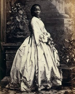 """Lady Sarah Forbes Bonetta Davies (photographed by Camille Silvy, 1862) She was born into a royal West African dynasty, and was orphaned in 1848, when she was around five years old, when her parents were killed in a slave-hunting war. In 1850, Sarah was taken to England and presented to Queen Victoria as a """"gift"""" from the King of Dahomey. She became the queen's goddaughter and a celebrity known for her extraordinary intelligence.  She spent her life between the British royal household and her…"""