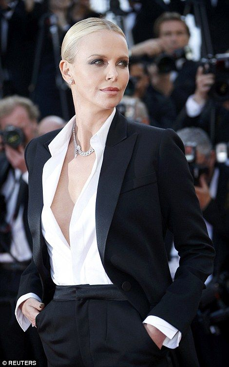 Charlize Theron made like one of the boys when it came to her premiere style as she dazzled in an androgynous look at the screening of The Last Face in Cannes on Friday.