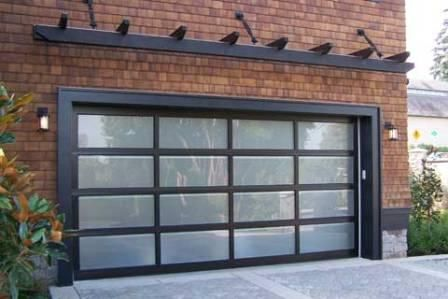 Sleek frosted glass garage door with matching pergola trellis really compliments the brick exterior.