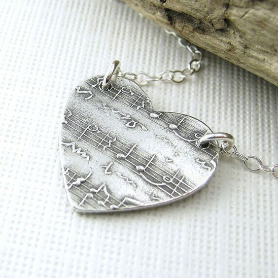 Music lyric sheet in a heart necklace