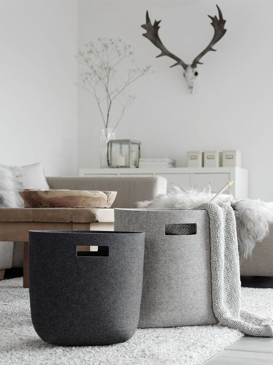 Apartment Decor Idea - 8 Ways To Decorate With Textiles // Baskets of blankets scattered around your apartment give you a convenient spot to store extra blankets, pillows, and other things you don't want to have lying around the apartment.