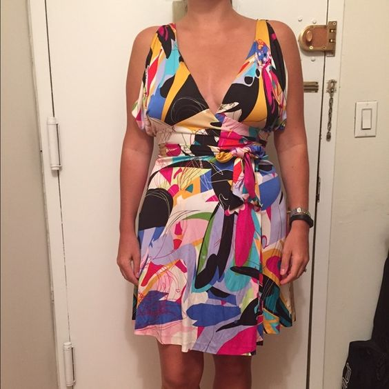Diane Von Furstenberg wrap dress size 10 Worn once- DVF multicolor sleeveless wrap dress. Bright geometric print! Silk/nylon. Size 10. Diane von Furstenberg Dresses