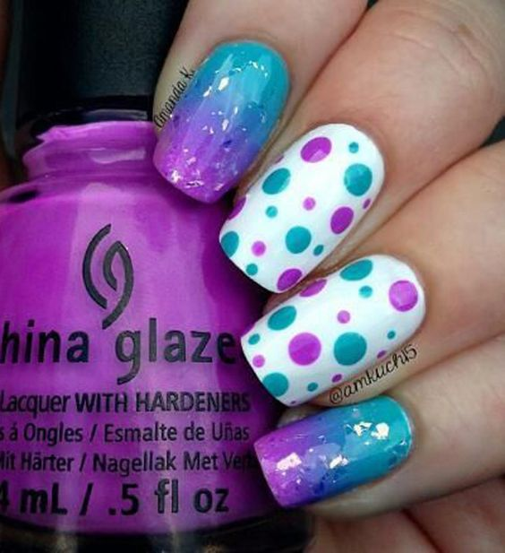 A really cute gradient and polka dot Purple nail art design. Paint on different sizes of polka dots as well as a candy colored gradient effect on your nails to make it really fun and interesting.
