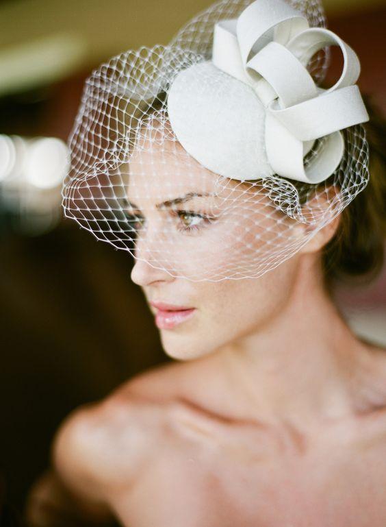Small white felt and veil bridal headpiece
