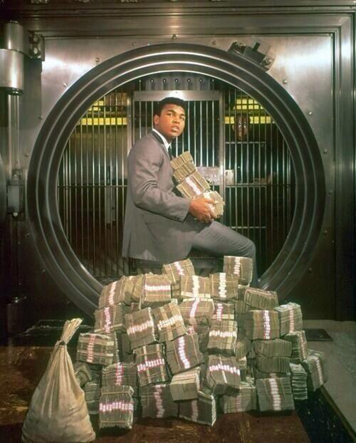 Muhammad Ali with his winnings