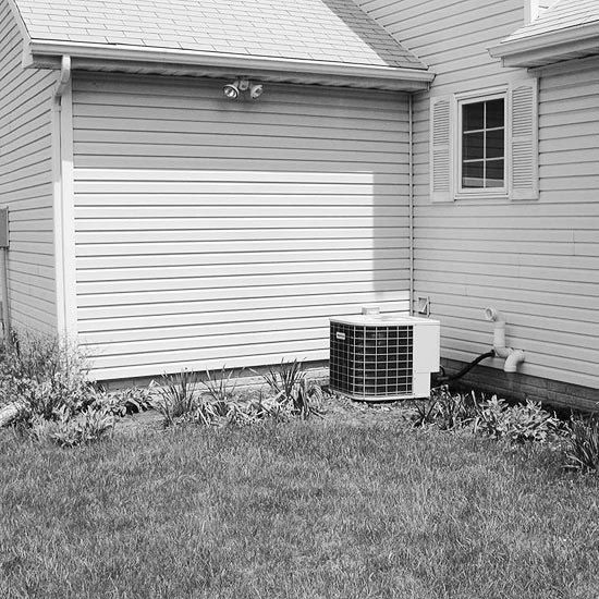 BEFORE: An Unsightly Air Conditioner AFTER: A Lush, Low-Care Planting