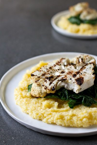 grilled cauliflower steaks with roasted red pepper sauce, polenta, and greens