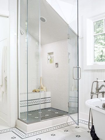Building a shower under the sloping roofline conceals the eave's protrusion into the room. It also preserves space for other amenities, such as the tub. Floor tiling in the room and the shower ties the spaces together.: