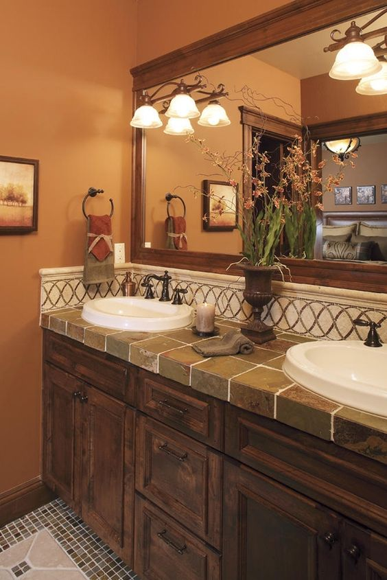 Bathroom. Excellent combination of dark cabinets and tile countertop.