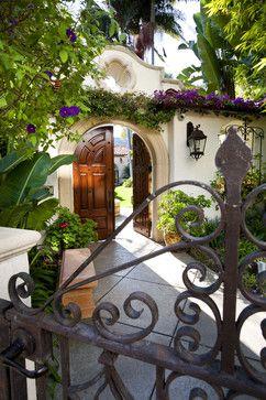 Camelback Mountain Villas - mediterranean - exterior - phoenix - Sennikoff Architects. White stucco wall, wrought iron gate with flowers and greenery