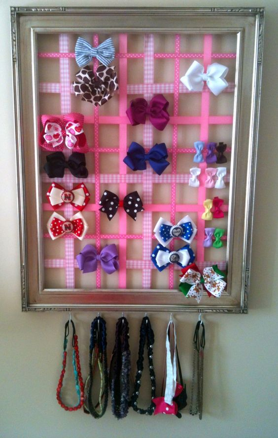 and I need the hooks for her double ruffle ribbons - I saw a board like this with hooks, and then curtain rod hangers.  hair-bow organization if i have a girl i must-have.